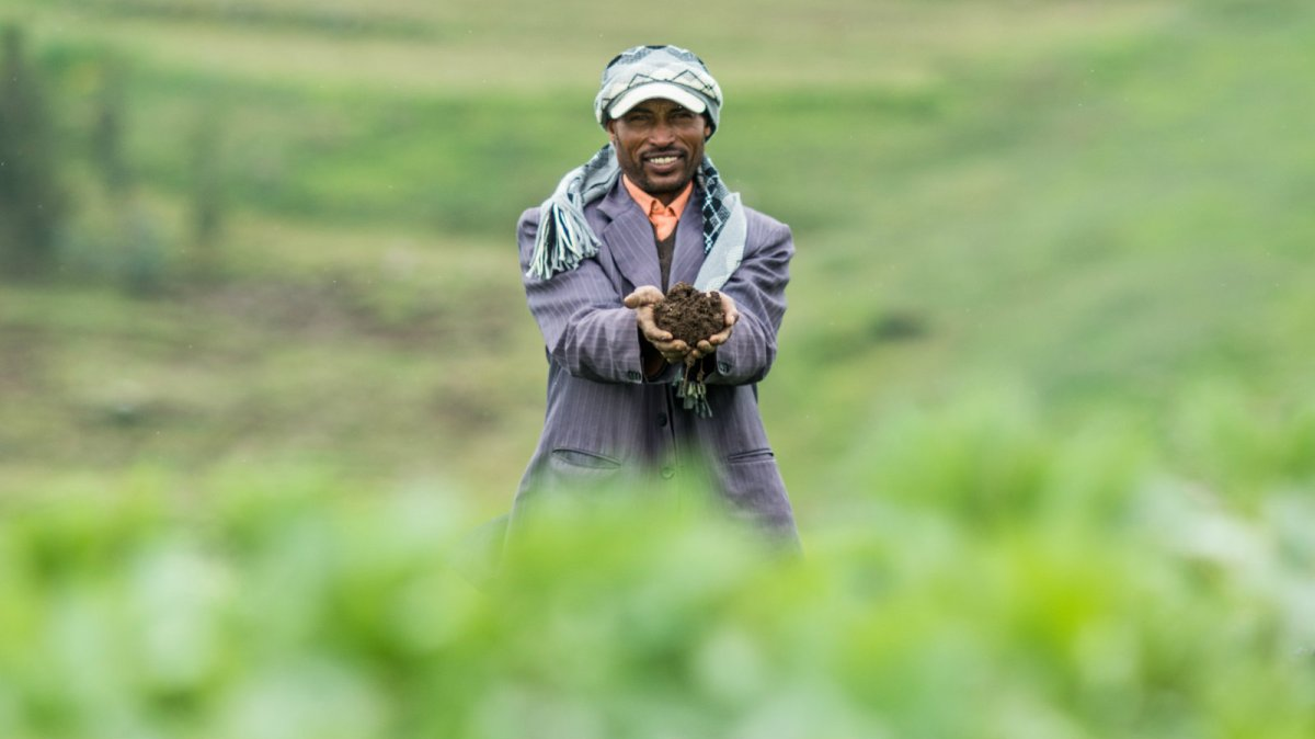Ethiopian farmer and soil
